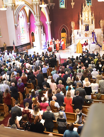 BRYAN EATON/Staff photo. The Ordination and Consecration of Andrew Williams as bishop of the Anglican Diocese of New England was held in Amesbury's Holy Family Parish due to its larger seating capacity. Clergy from around the world attended the event as well as The Most Reverend Dr. Foley Beach, Archbishop of the Anglican Church of North America who presided.
