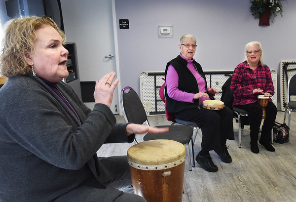 BRYAN EATON/Staff photo. Elaine LaReau, center, and Betty Guy join in as Nancy VanBenschoten, left, leads a drum class at the Salisbury Council on Aging's Hilton Senior Center.