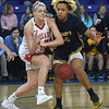 JIM VAIKNORAS/Staff photo Amesbury's Flannery O'Connor is fouled by St.Mary's Jannise Avelino in the D3 North final at the Tsongas Center in Lowell Saturday. St. Mary's won the game 59-48.
