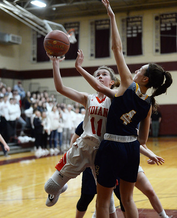 CARL RUSSO/staff photo. Amesbury's Avery Hallinan drives to the hoop against Lynnfield's Catherine MacDonald. Amesbury girls basketball vs. Lynnfield in Division 3 North semifinals. 3/6/2019