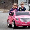 BRYAN EATON/Staff photo. Ozzie Tonk, 6, takes the wheel of his friend five year-old Quinn Welch's model Cadillac for a spin in their neighborhood off Whitehall Road in Amesbury on Thursday afternoon. The friends and others in their neighborhood were out enjoying the first full day of spring when they got out of school.