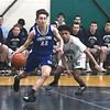 JIM VAIKNORAS/Staff photo Georgetown's Justin Murphy drives past Lowell Catholic's Keenan Rudy-Phol at Lowell Catholic Saturday.