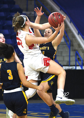 JIM VAIKNORAS/Staff photo Amesbury's Alli Napoli gets fouled by  St.Mary's Ashley Sullivan in the D3 North final at the Tsongas Center in Lowell Saturday. St. Mary's won the game 59-48.