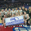 JIM VAIKNORAS/Staff photo Pentucket players pose with the D2 North Sectional Final trophy at the Tsongas Center in Lowell.
