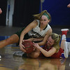 JIM VAIKNORAS/Staff photo Pentucket's Angelica Hurley fights for a loose ball with Tewksbury's  Kiley Tibbetts  Saturday in the D2 North Sectional Final at the Tsongas Center in Lowell.