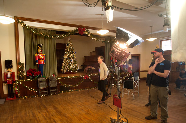 """JIM VAIKNORAS/Staff photo Mason Hall in Newburyport is decked out for the holiday as a scene from """"A Ring for Christmas"""" is filmed Sunday."""