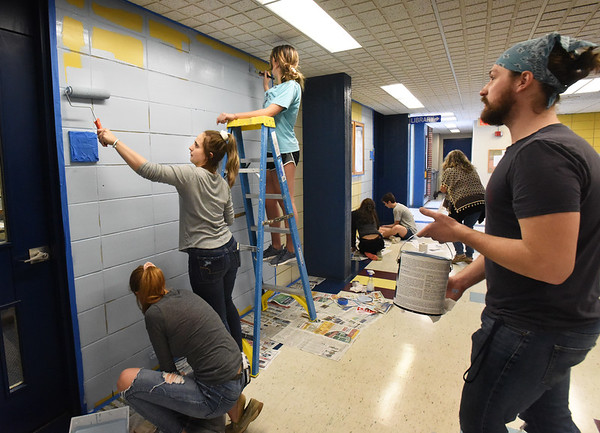 BRYAN EATON/Staff photo. Triton High School Student Council members paint some walls blue at the Byfield school which is one of the school colors. They were prepping for Saturday's Viking Day of Giving part of a spirit campaign at the school.