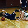 CARL RUSSO/staff photo. Pentucket's MacKenzie Currie, right and Swampscott's Sophie Digrande hit the floor fighting for the ball. Pentucket vs. Swampscott girls basketball in the Division 2 North semifinals. 3/5/2019