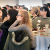 BRYAN EATON/Staff photo. Attendees to the Jeanne Geiger Crisis Center's White Ribbon Breakfast listen to youngsters as they read Student Reflections.