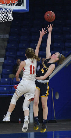 JIM VAIKNORAS/Staff photo Amesbury's Avery Hallinan defends St.Mary's Olivia Matela in the D3 North final at the Tsongas Center in Lowell Saturday. St. Mary's won the game 59-48.