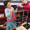 "BRYAN EATON/Staff photo. Clover Eichler, 7, gets help from her grandmother Ellen Tirone of Newburyport as she constructs a building made of straws during STEM Structures in the Children's Room at the Newburyport Public Library on Tuesday afternoon. Clover is visiting from San Francisco, where there's school vacation, for her ""birthday week"" though she doesn't turn eight for a couple weeks."