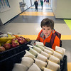 JIM VAIKNORAS/Staff photo Fifth grader Danny Marshall grabs food at the new breakfast cart at the Molin School in Newburyport.