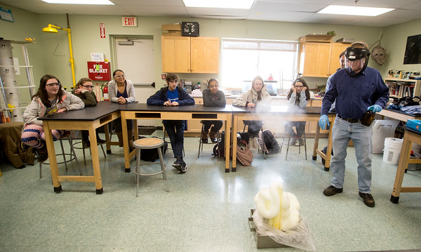 JIM VAIKNORAS/Staff photo Dave Geissles of STREM Chemical demonstrates the use of a catalyst by combining potassium iodide with hydrogen peroxide and soup, also know as the Elephant's Toothpaste, in Rebecca Schwer's class at the River Valley Charter School in Newburyport Wednesday.
