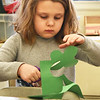 BRYAN EATON/Staff photo. Kyle Ray, 6, cuts out a shamrock she traced in the art room at the Boys and Girls Club in Salisbury overseen by Coreen Pecoraro. She was hoping to make five of them to take home for St. Patrick's Day.