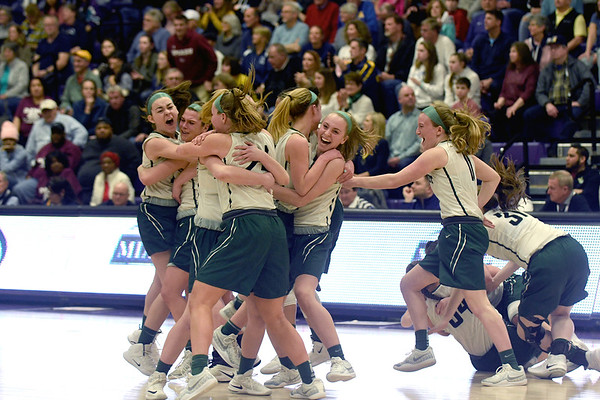 JIM VAIKNORAS/Staff photo Pentucket players  celebrate winning the State Championship after defeating North Hampton at Holy Cross in Worchester Saturday.