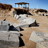 BRYAN EATON/Staff photo. The weekend's strong waves and wind caused some erosion on Plum Island Point taking away the steps that lead to the beach from the pergola at the end of the boardwalk. It also exposed these concrete blocks.
