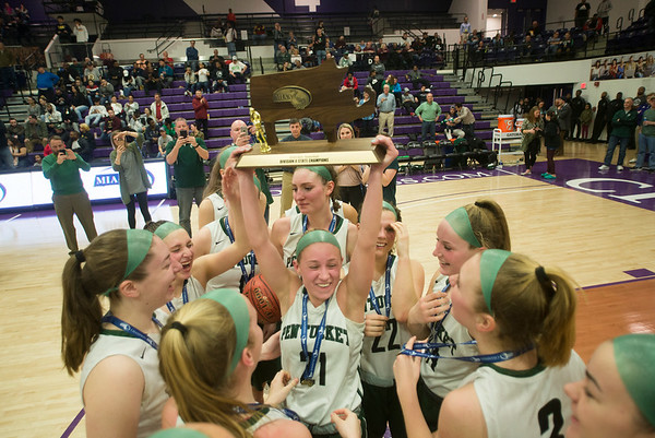 JIM VAIKNORAS/Staff photo Pentucket's Madeline Doyle holds up the State Championship trophy at Holy Cross in Worchester Saturday.