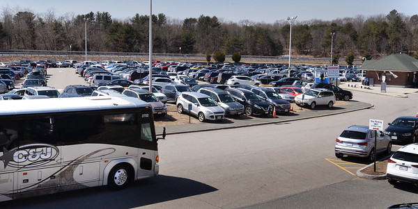 BRYAN EATON/Staff Photo. A C&J Trailways bus pulls into the commuter lot on Storey Avenue in Newburyport on Thursday afternoon. The Coach Company is ending service next month with C&J expected to pick up the slack.