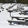 JIM VAIKNORAS/Staff photo With spring just around the corner, snow covers picnic tables, grills, and power outlets at the camp ground at Salisbury Beach Reservation Wednesday morning.