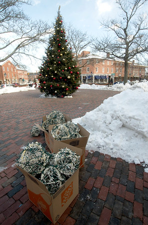 """JIM VAIKNORAS/Staff photo A boxes of Christmas lights and a tree sit in Market square in Newburyport Thursday. The holiday items are props for a movie """"Ring for Christmas"""" being filmed in the city."""