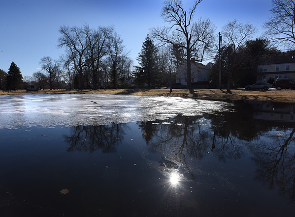BRYAN EATON/Staff photo. Though the temperature was a little below normal on Monday, melting has been going on, here in a view of the pond on Newbury's Upper Green. The temperature does warm as the week goes on with spring officially arriving tomorrow.