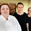 BRYAN EATON/Staff photo. An Irish-themed fundraiser for Lungstrong is being hosted by Ristorante Molise sisters, Antonietta DeLemme, left, and Elisa Zullo, center, with server Julie Tanzella who will be working the event.