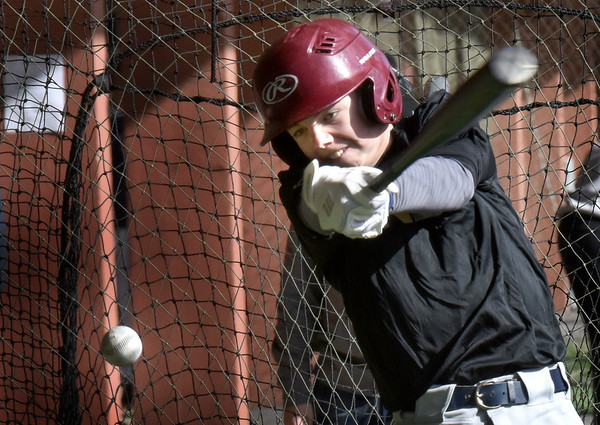 BRYAN EATON/Staff photo. Owen Roberts makes some hits in the batting cage.