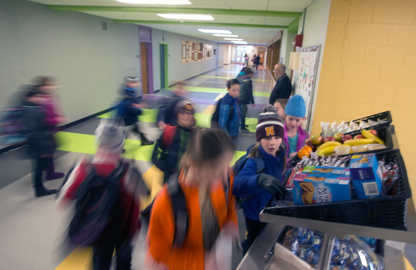 JIM VAIKNORAS/Staff photo Students rush to pick up items at the new breakfast cart at the Molin School in Newburyport.