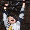 "BRYAN EATON/Staff photo. The nice weather brought the children from the Newburyport YWCA Afterschool Program outside to the Bresnahan School playground yesterday. Colin Farmer, 7, moves along the monkey bars with a ""caterpillar"" on his lip as it was Moustache Monday."