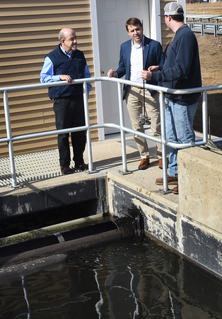 BRYAN EATON/Staff photo. New Hampshire Congressman Chris Pappas, center, got a tour of Seabrook's Wastewater Treatment Plant with superintendent Phil Maltais, left, and chief operator Nils Larson.
