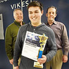 BRYAN EATON/Staff Photo. A winner in the DECA Stock Market Game, Triton student Joseph Luciano is flanked by DECA advisor Joe Celia, left, and his business teacher Richard FIsher, right.