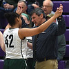 JIM VAIKNORAS/Staff photo Pentucket coach John McNamara greet player Arielle Cleveland after defeating North Hampton at Holy Cross in Worchester Saturday.