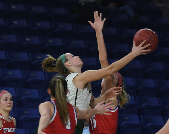 JIM VAIKNORAS/Staff photo Pentucket's Angelica Hurley glides to teh basket against Tewksbury Saturday in the D2 North Sectional Final at the Tsongas Center in Lowell.