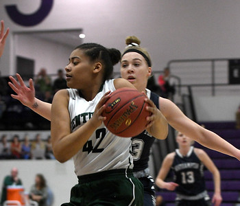 JIM VAIKNORAS/Staff photo Pentucket 's Arielle Cleveland drives to the basket against North Hampton at Holy Cross in Worchester Saturday.