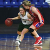 JIM VAIKNORAS/Staff photo Pentucket's Jessica Galvin is guarded by Tewksbury's Allison Wild  Saturday in the D2 North Sectional Final at the Tsongas Center in Lowell.