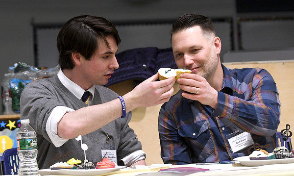 """JIM VAIKNORAS/Staff photo Bresnahan School music teacher Gardner Rulan-Miller and Zach Field of Zach Field Drum Studio toast before judging a cup cake bake-off  at the Friends of Newburyport Youth Services """"Hello Spring"""" celebration at the Bresnahan School in Newburyport Saturday. The event also included more than 500 cupcakes for sale, music, carnival games, music, and a cupcake bake-off."""