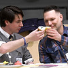 "JIM VAIKNORAS/Staff photo Bresnahan School music teacher Gardner Rulan-Miller and Zach Field of Zach Field Drum Studio toast before judging a cup cake bake-off  at the Friends of Newburyport Youth Services ""Hello Spring"" celebration at the Bresnahan School in Newburyport Saturday. The event also included more than 500 cupcakes for sale, music, carnival games, music, and a cupcake bake-off."