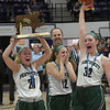 JIM VAIKNORAS/Staff photo Pentucket player #21 Madeline Doyle, #12 Jessica Galvin, and #32 Olivia Cross celebrate with the State Championship trophy after defeating North Hampton at Holy Cross in Worchester Saturday.