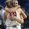 JIM VAIKNORAS/Staff photo Amesbury's Alli Napoli hugs teammate Flannery O'Connor after their 59-48 loss to  St.Mary's  in the D3 North final at the Tsongas Center in Lowell Saturday.