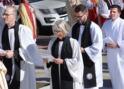 BRYAN EATON/Staff photo. Rev. Andrew Williams, far right, in the procession into the Holy Family Parish for his Ordination and Consecration as bishop in the Anglican Diocese of New England on Saturday.