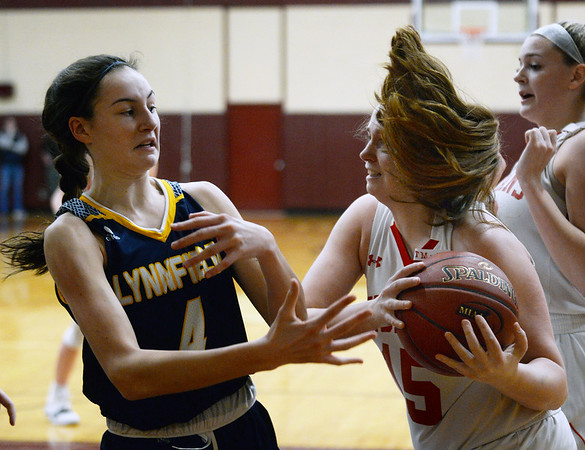 CARL RUSSO/staff photo. Amesbury's Mary Bullis fights for the rebound with Lynnfield's Catherine MacDonald. Amesbury girls basketball vs. Lynnfield in Division 3 North semifinals. 3/6/2019
