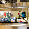JIM VAIKNORAS/Staff photo Students make their way by the new breakfast cart at the Molin School in Newburyport.