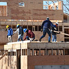 BRYAN EATON/Staff photo. Members of Living Water Catholic of Amesbury volunteered their time Saturday helping out on the housing units of a Habitat For Humanity project. The housing will hold seven units on Old County Road in Salisbury.