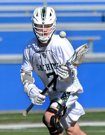 CARL RUSSO/staff photo. Pentucket's Josh Smith, keeps his eye on the ball in lacrosse action against Boston Latin. <br /> <br /> The Pentucket boys lacrosse team is off to a great start, and Kevin Kershaw has played a big part in that success. The senior, who has never been a major contributor on the team before this season, has burst out with a team-high 22 goals through the team's first five games, including three games with six or more goals. 4/17/2019