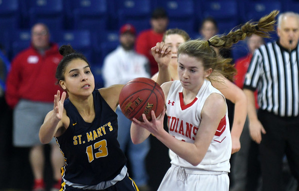 JIM VAIKNORAS/Staff photo Amesbury's Avery Hallinan drives to the basket against St.Mary's Pamela Gonzalez in the D3 North final at the Tsongas Center in Lowell Saturday. St. Mary's won the game 59-48.