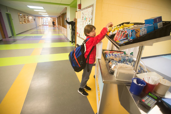 JIM VAIKNORAS/Staff photo Fourth grader Owen Mongeau picks out an item at the breakfast cart at the Molin School in Newburyport.