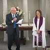 JIM VAIKNORAS/Staff photo Reverend Rebecca Michaela Bryan smiles as she is  installed by Parish Board Chair Art Henshaw as the 16th settled minister of the First Religious Unitarian Universalist Church in Newburyport Sunday.