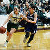 CARL RUSSO/staff photo. Pentucket's Angelina Yacubacci drives to the hoop against Swampscott's Sophie Digrande. Pentucket vs. Swampscott girls basketball in the Division 2 North semifinals. 3/5/2019