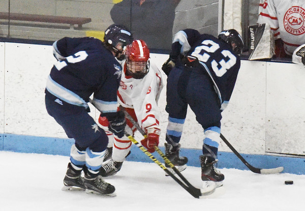 BRYAN EATON/Staff photo. Masco's Kirby Glynn is squeezed between Cael Kohan and James Tatro, right.