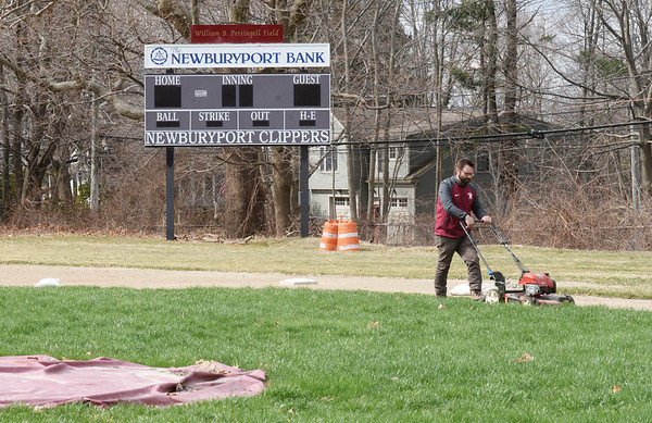 BRYAN EATON/Staff photo. Newburyport High athletic fields' groundkeeper Bryan Montejunas mows the baseball diamond as the field remains closed to the public as school is still out over the threat of coronavirus.